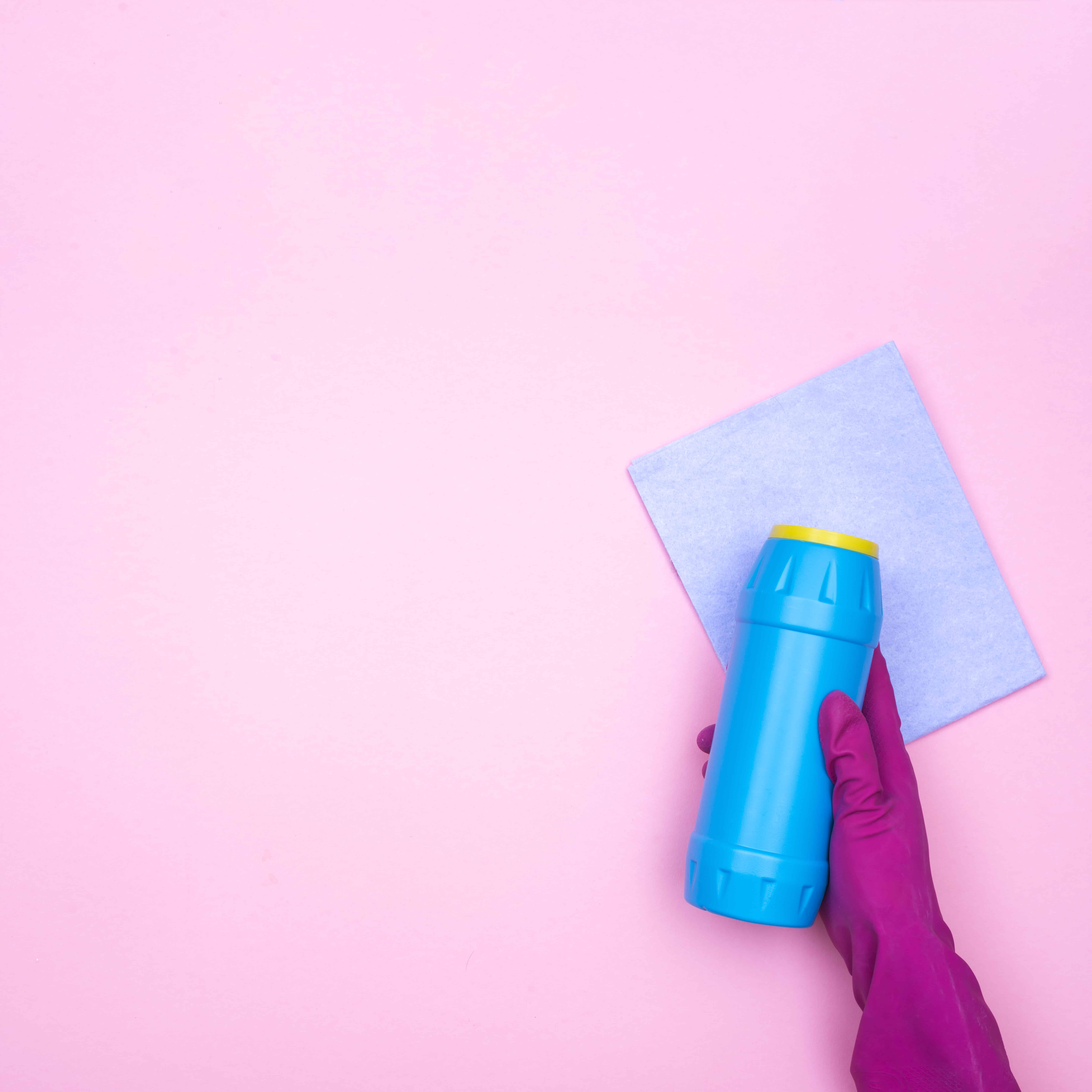 cleaning products on pink background