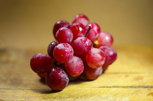 red grapes on wooden top